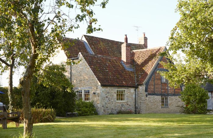 Redbridge Cottage is a medieval property dating from 1390 that has been lovingly restored