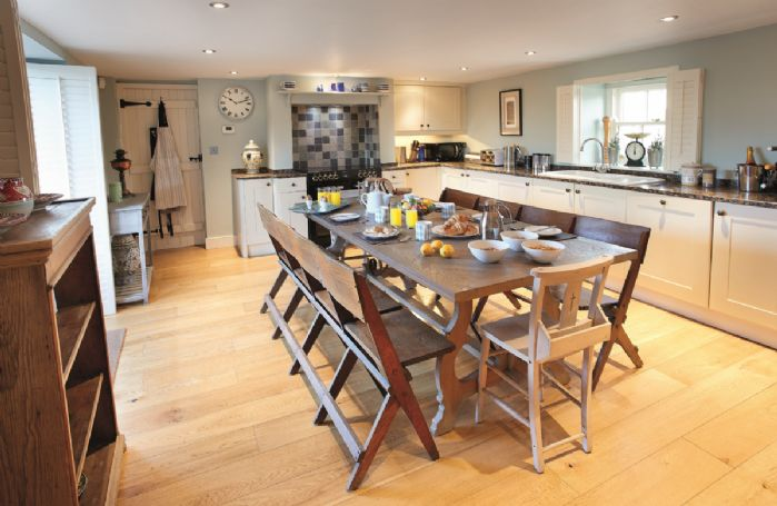Ground floor: Large well-equipped Kitchen/Breakfast Room seating 10 guests and wonderful views onto the courtyard and garden