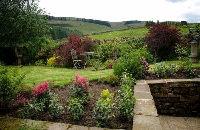 Private garden with open countryside views