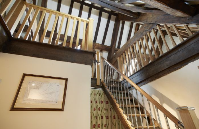 First floor: Stairs to galleried attic