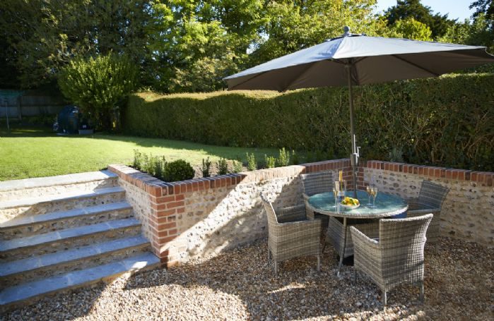 Pretty rear garden with garden furniture