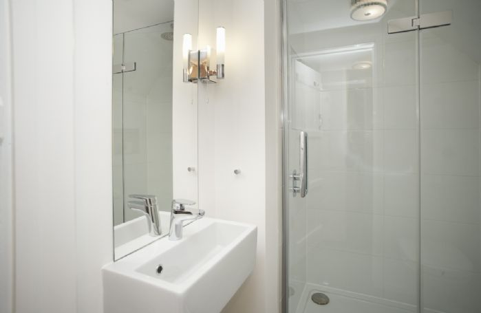 First floor: Shower room with walk in shower, basin and wc