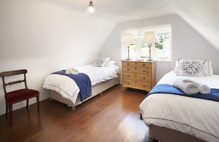 First floor:  Second bedroom with 6' zip and link bed which can be converted to two 3' single beds on request