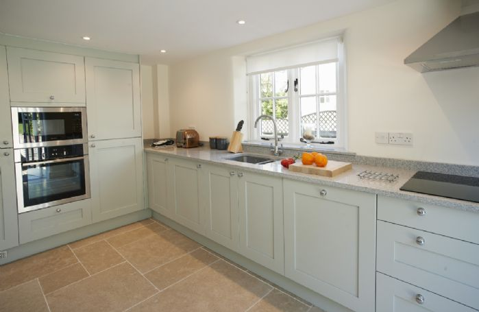 Ground floor: Fitted kitchen with door to garden
