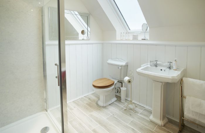 First floor: spacious family bathroom featuring underfloor heating, and separate walk in shower.