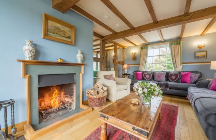Ground floor: L-shaped sitting room with open log fire