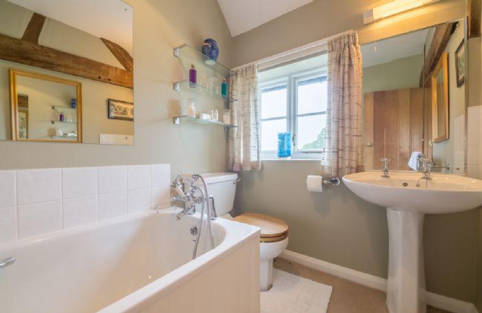 First floor:  En-suite bathroom in House