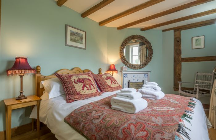 Ground floor: Double bedroom with 5' bed in House