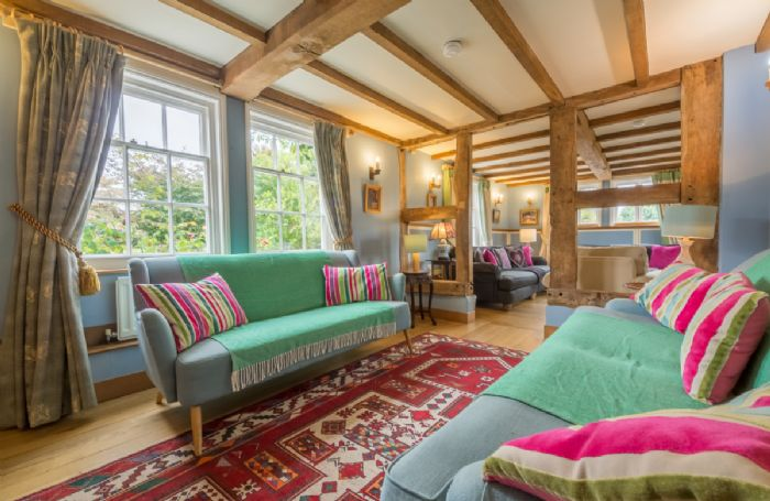 Ground floor: L-shaped sitting room with open log fire in House