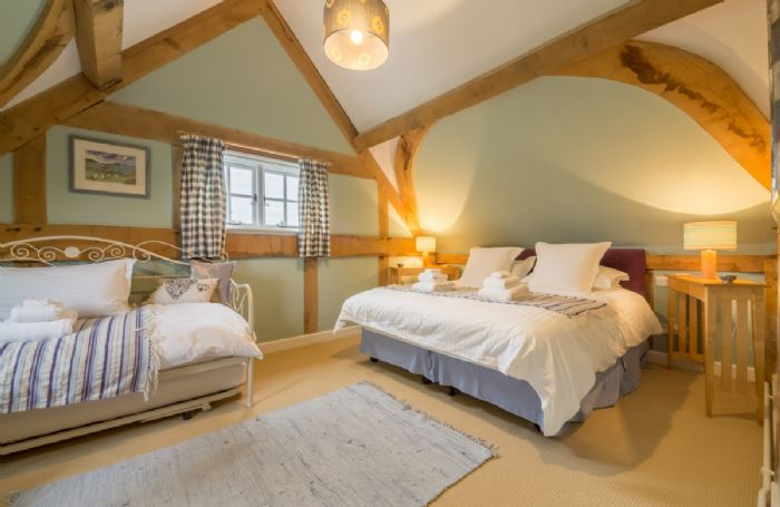 First floor: Double bedroom with 6' zip and link bed in Cottage along with 3' day-bed