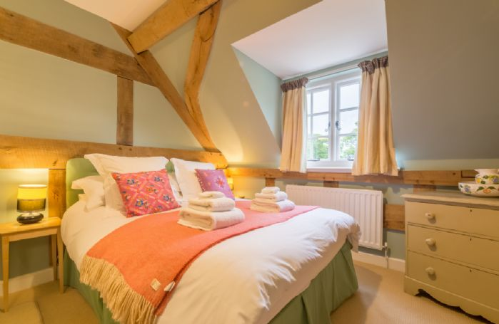 First floor: Double bedroom with 5' bed in Cottage