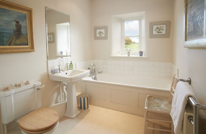 First floor: Family bathroom with bath and hand-held shower attachment