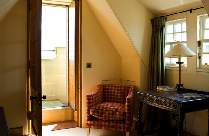 Fourth floor: The Garret Suite has its own private sitting area with outside access to the battlements with views across the hills to Edinburgh