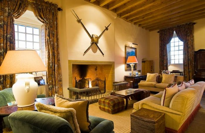 First floor: The Great Hall is a relaxing sitting room with soft, comfortable seating, beautiful furnishings and a stately fireplace