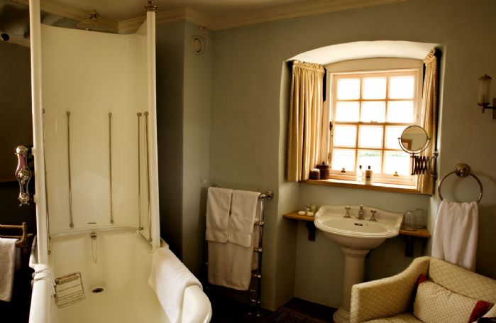 Second floor: The adjacent bathroom includes an original Doulton of Paisley canopy bath and a day bed