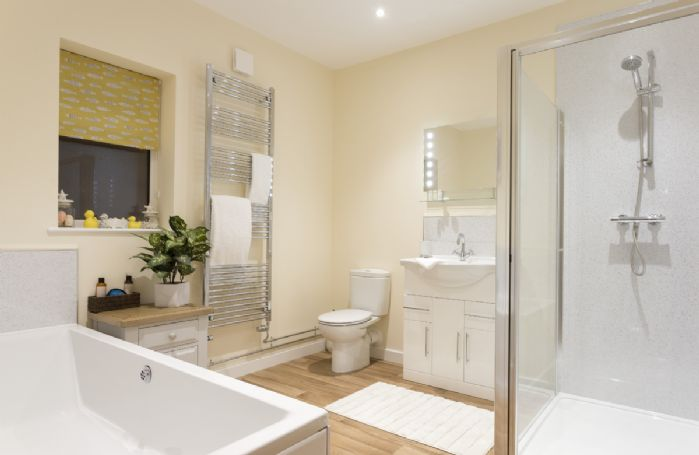 Ground floor: Large family bathroom with double ended bath and separate walk in shower