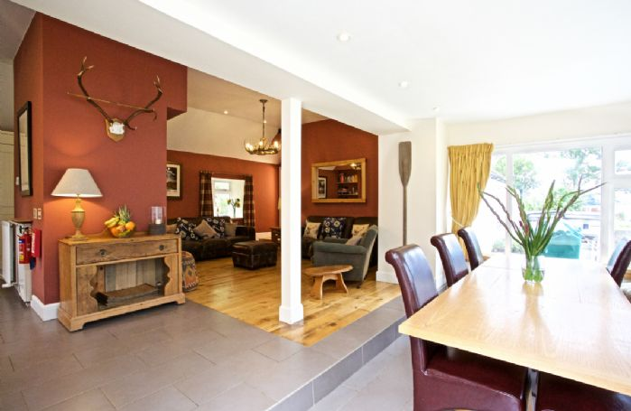 The open plan living dining and kitchen area offers private views of Loch Tay just metres from the property