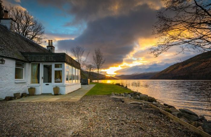 Lochside Cottage sits directly on the shores of Loch Tay in the in the Perthshire village of Kenmore