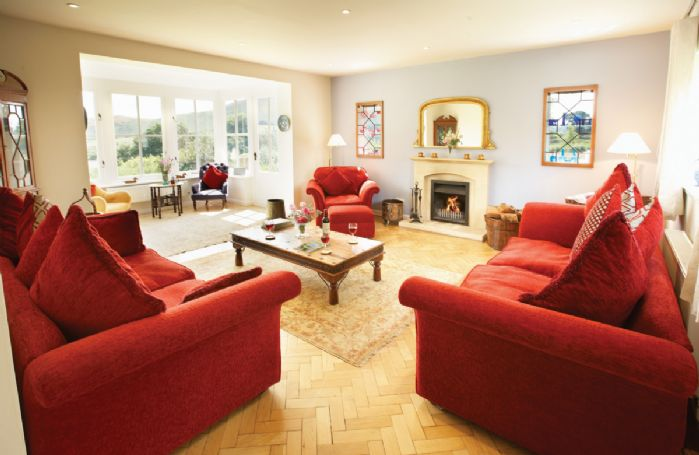Ground floor:  Sitting room with large bay window with extensive views