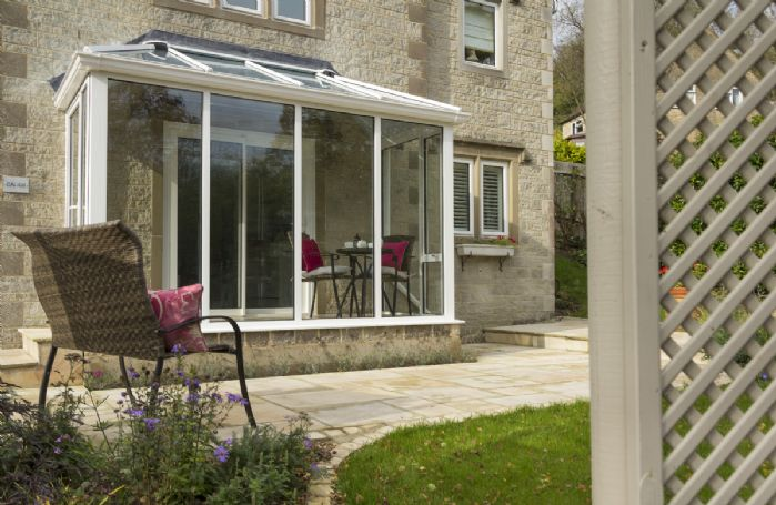 There is a second set table and chairs in the small conservatory that looks on to the garden