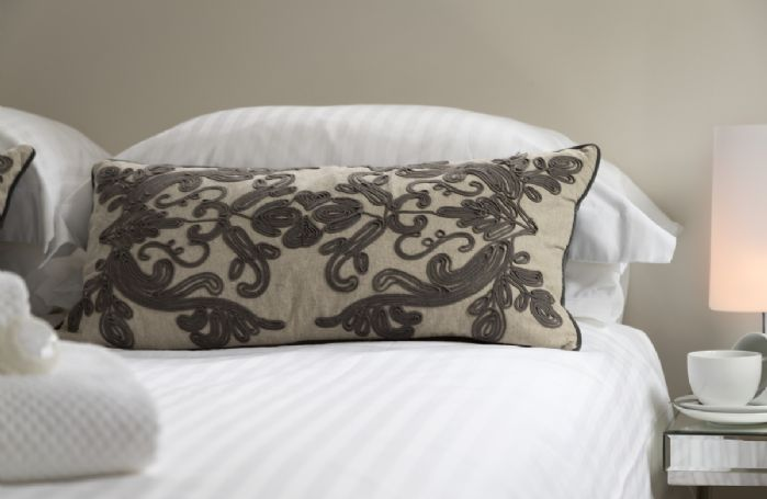 Comfortable furnishings with silk cover and pillows