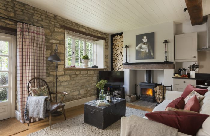 Ground floor: Open plan kitchen and sitting room with wood burning stove