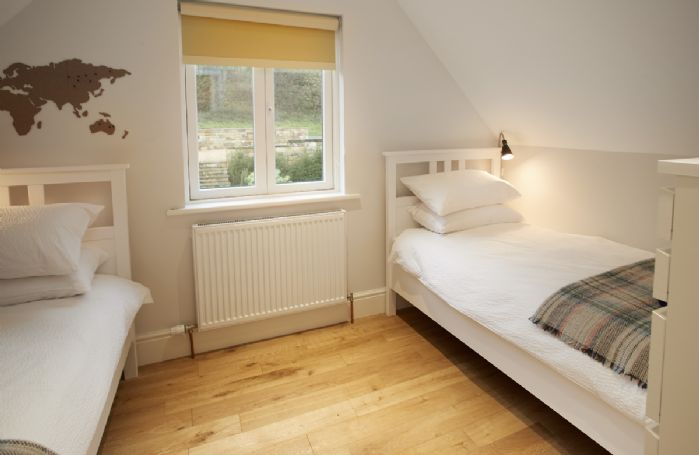 First floor: Bedroom Four has two single beds