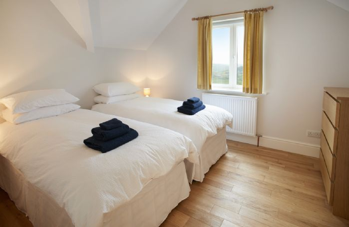 First floor: Bedroom Two has two singles which can be converted to a super king bed on request