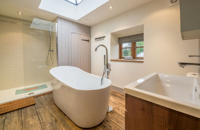 First floor: The bathroom features a freestanding modern bath tub and large walk-in shower
