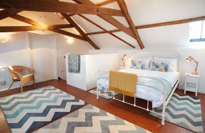 First floor: Bedroom with 5' king-size bed and vaulted ceiling