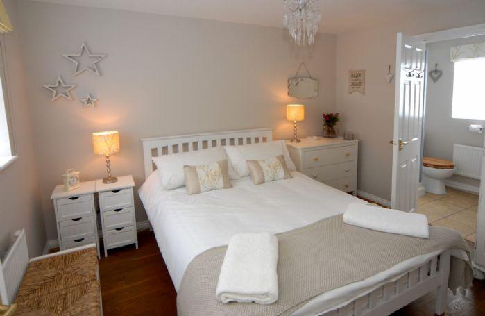 First floor: Master bedroom with 4'6 double bed and en-suite shower room