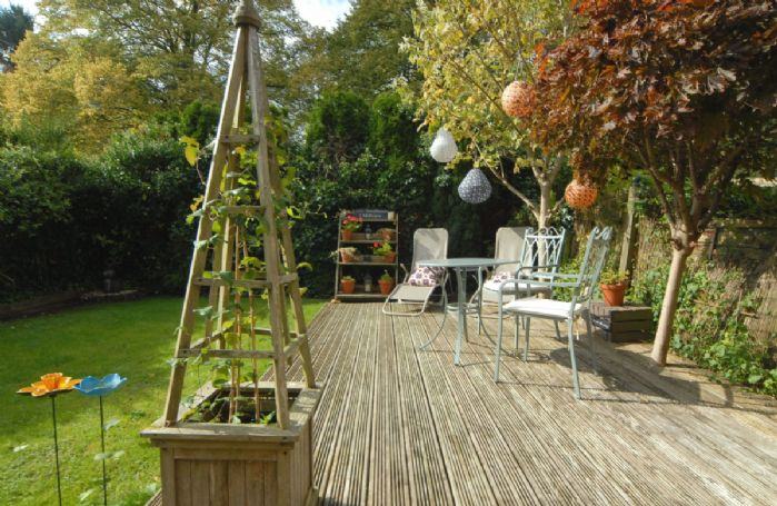 Fully enclosed garden with raised decking area