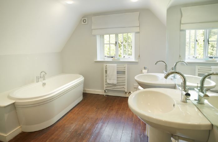 First floor: Bathroom with twin basins, bath, separate shower and wc