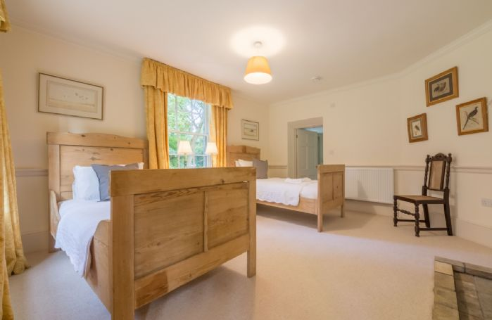 Ground floor: Bedroom three with two 3' single beds and en-suite bathroom