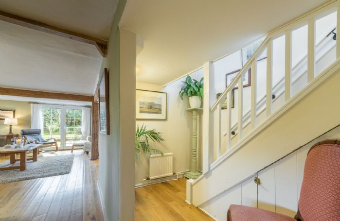 The staircase leads from the ground floor dining area to the first floor bedrooms