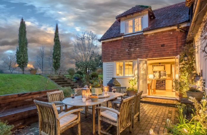 Cherry Cottage has several paved terraces, the largest of which has garden furniture seating six