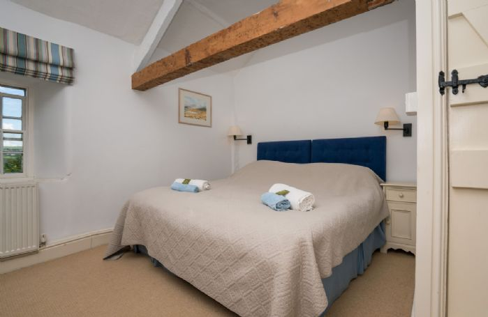 First floor: Twin/double bedroom with 3' zip and link beds which can be converted into a 6'