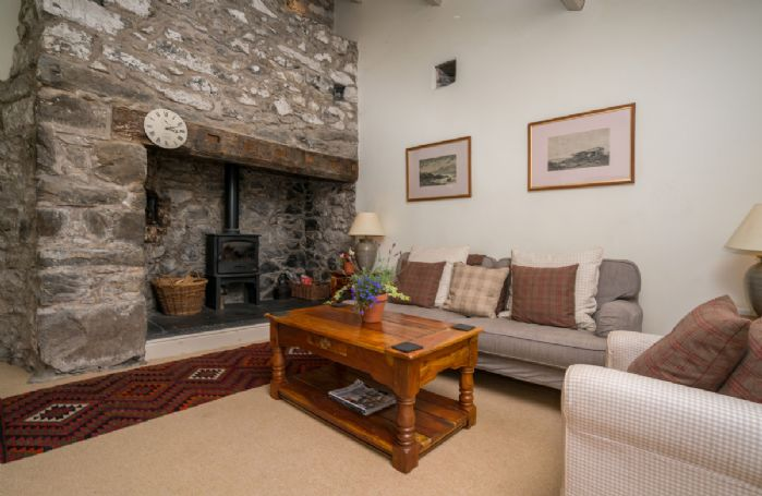 Ground floor:  Sitting room with slate floor and wood burning stove