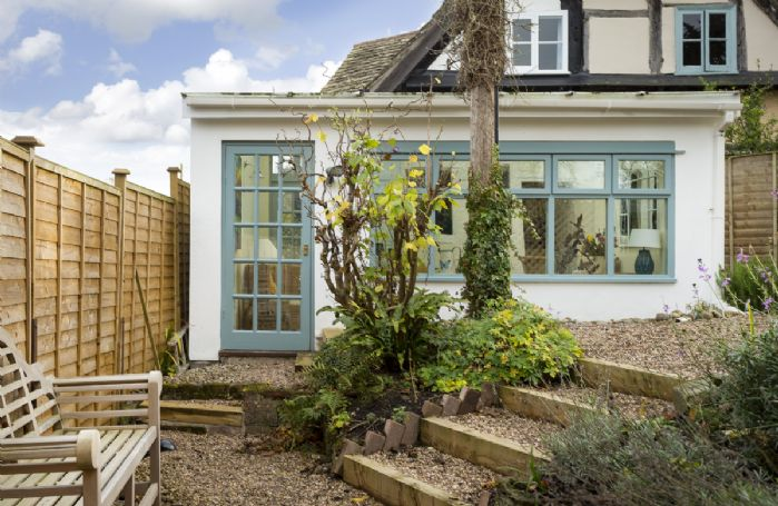 The conservatory opens on to an attractive pebbled garden