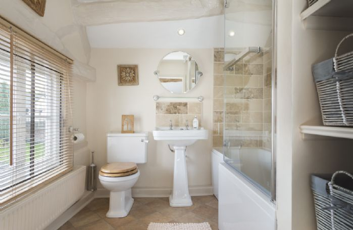 First floor: Family bathroom with bath and electric shower over
