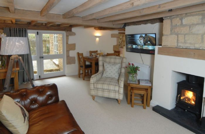 Ground Floor: comfortable seating in front of the wood-burning stove