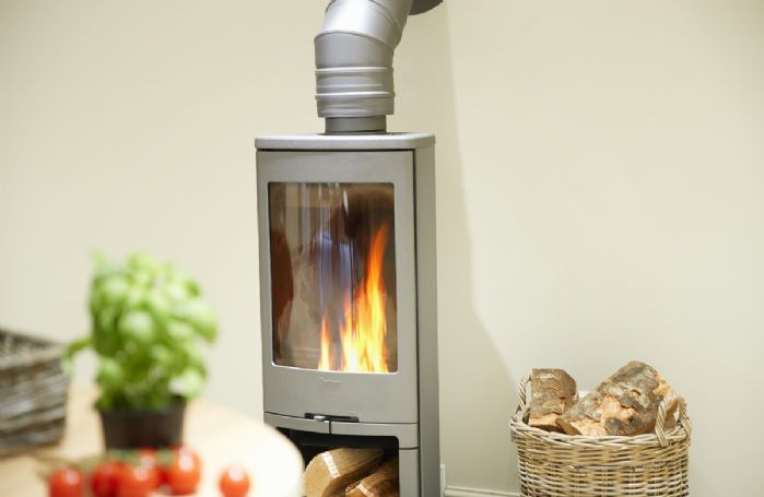 The kitchen/dining are features a wood burning stove