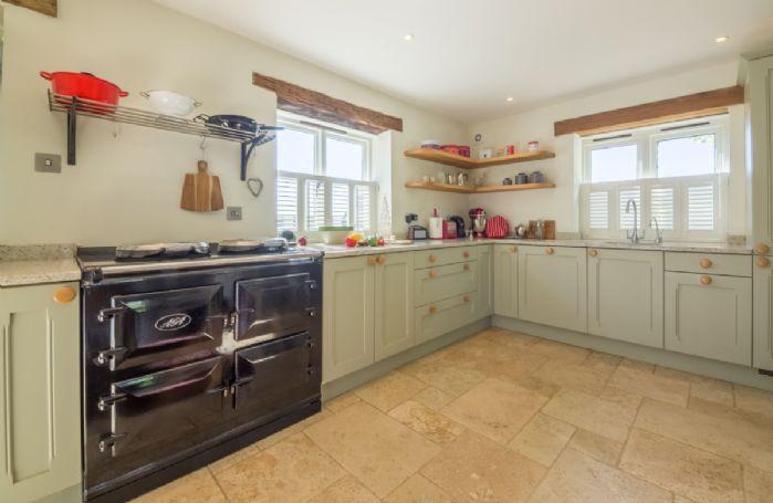 Ground floor: Painted shaker-style kitchen with AGA range