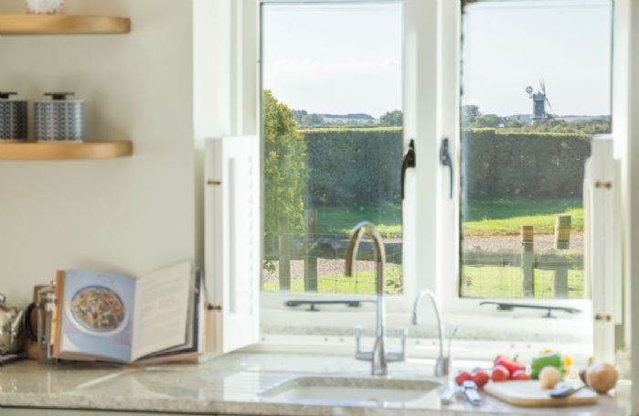 Ground floor: Painted shaker-style kitchen  which affords beautiful views of Bircham Windmill