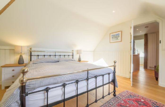 First floor: Second bedroom with 5' king-size bed