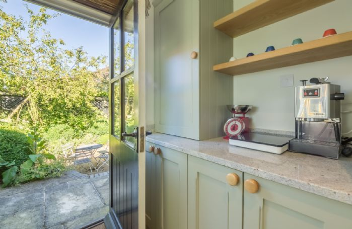Ground floor: Utility room leading to the enclosed garden with sunken patio
