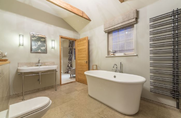 Ground floor: En-suite bathroom with free-standing bath and separate wet room shower