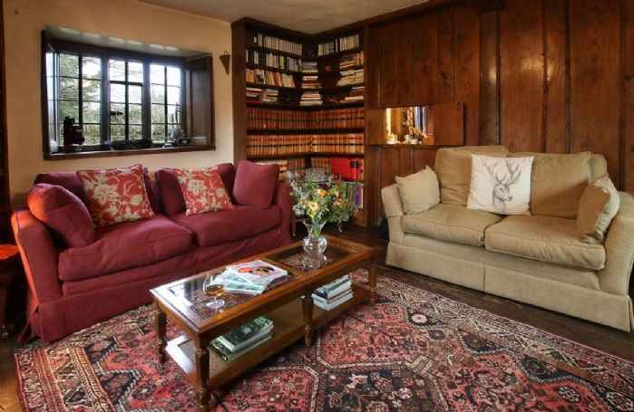 Ground floor: Wood paneled library with double aspect views