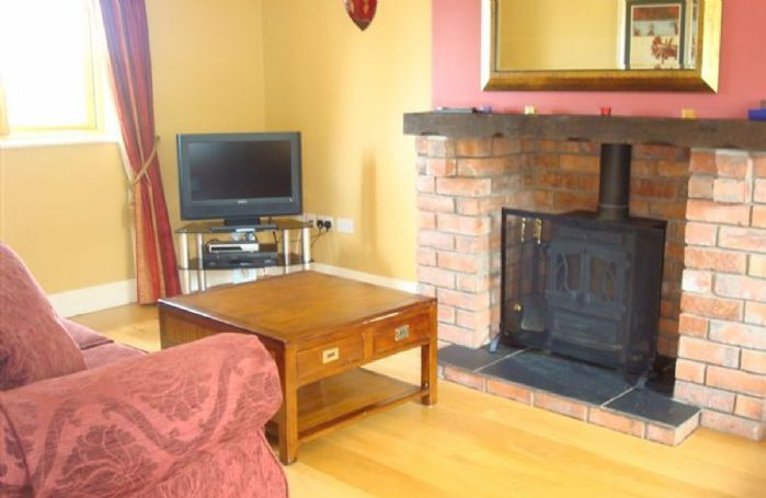 Ground floor: Sitting room with multi-fuel stove