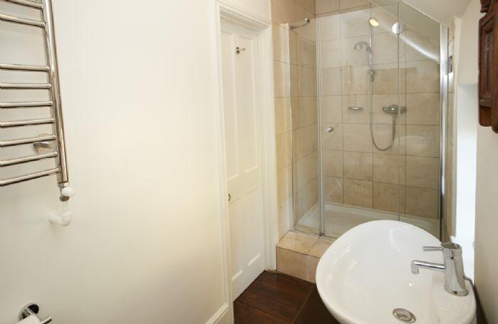 First floor: En-suite shower room accessed via the Chestnut bedroom